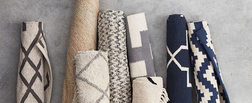 Wohntextilien - Kissen, Decken und Teppiche